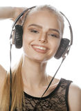 Young sweet talented teenage girl in headphones singing isolated on white Royalty Free Stock Photo