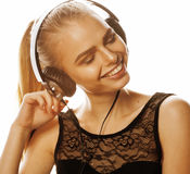 Young sweet talented teenage girl in headphones singing isolated on white Royalty Free Stock Image