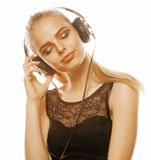Young sweet talented teenage girl in headphones singing isolated on white Royalty Free Stock Photos
