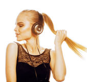 Young sweet talented teenage girl in headphones singing isolated. On white background Stock Photography