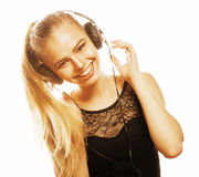 Young sweet talented teenage girl in headphones singing isolated. On white background Stock Photo