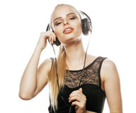 Young sweet talented teenage girl in headphones singing isolated Stock Image