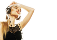 Young sweet talented teenage girl in headphones singing isolated. On white background Stock Photos