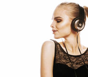 Young sweet talented teenage girl in headphones singing isolated. On white background Royalty Free Stock Image