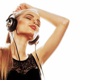 Young sweet talented teenage girl in headphones singing isolated. On white background Royalty Free Stock Photo