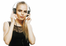 Young sweet talented teenage girl in headphones singing isolated. On white background Stock Images
