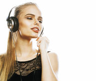 Young sweet talented teenage girl in headphones singing isolated. On white background Royalty Free Stock Photography