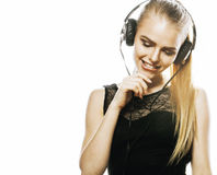 Young sweet talented teenage girl in headphones singing isolated Stock Photography