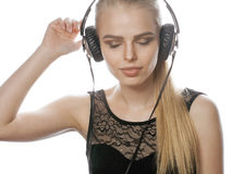 Young sweet talented teenage girl in headphones Royalty Free Stock Photo
