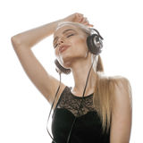 Young sweet talented teenage girl in headphones Royalty Free Stock Image