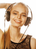 Young sweet talented teenage girl in headphones singing  on white Stock Photo
