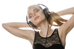 Young sweet teenage girl in headphones singing Stock Photos