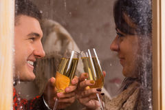 Young sweethearts celebrating with champagne Stock Photography