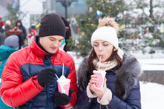 Young Sweethearts with Winter Cup Drinks Royalty Free Stock Photo