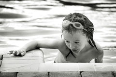 Young Swimmer. Black and white Portrait of a young swimmer with goggles Royalty Free Stock Image