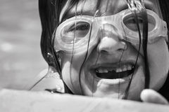 Young Swimmer. Black and white Portrait of a young swimmer with goggles and a missing tooth Stock Photo