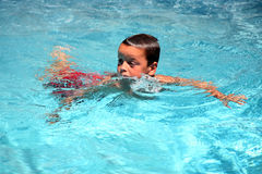 Young swimmer boy Stock Images