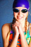 Young swimmer in a colorful suit and goggles Royalty Free Stock Photos