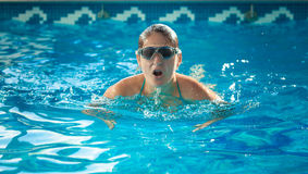 Young swimmer woman taking a breath at swimming pool Royalty Free Stock Photos