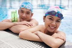 Young swimmers. Portrait of happy young swimmers looking at the camera Royalty Free Stock Images