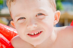 Young swimming and smiling boy Stock Images
