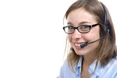 A young switchboard operator smiling at the camera Royalty Free Stock Photos