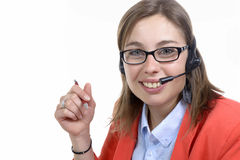 A young switchboard operator smiling at the camera Royalty Free Stock Photography