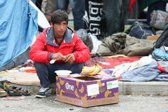 Young Syrian man eating on border Royalty Free Stock Images