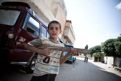 Young syrioan boy plays with wooden gun.Azaz,Syria. Royalty Free Stock Images