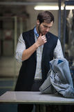 Young tailor man in action Royalty Free Stock Photos