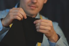 Young tailor sewing in atelier royalty free stock image