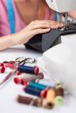 Young tailor sews a pair of trousers, horizontal Stock Photos