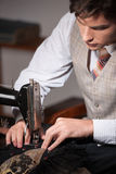 Young tailor at work. Stock Images