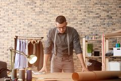 Young tailor working in atelier stock photos