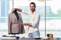 The young tailor working on new clothing design Royalty Free Stock Images