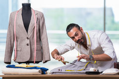 The young tailor working on new clothing design Stock Photos