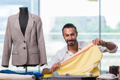The young tailor working on new clothing design Royalty Free Stock Photo