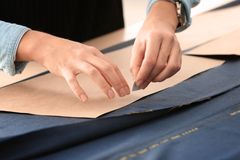 Young tailor working with sewing pattern. Closeup Stock Photo