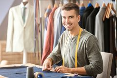 Young tailor working with textile Stock Photo