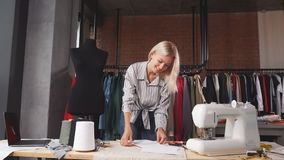Young talented designer creating outfit.  stock footage