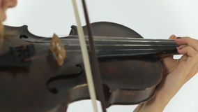 Young talented girl masterfully plays the violin stock video