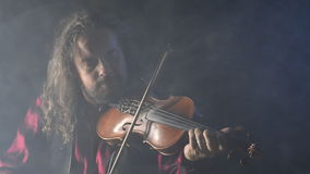 Young talented violinist creating music with his violin stock footage
