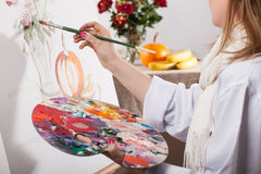 Young talented woman painting Royalty Free Stock Image