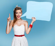 Young talkative woman showing sign speech bubble banner looking happy excited Royalty Free Stock Photos