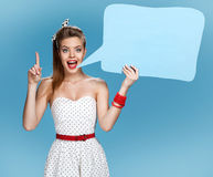 Young talkative woman showing sign speech bubble banner looking happy excited Stock Photography