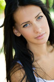 Young tanned brunette beauty. Stock Photo