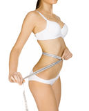 Young tanned woman measuring her body Royalty Free Stock Photo