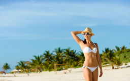 Young tanned woman relaxig at tropical caribbean beach Stock Image