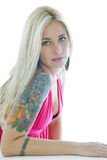 Young tattoed woman. Isolated on white royalty free stock photography