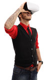 Young tattooed man using a VR headset Stock Photos